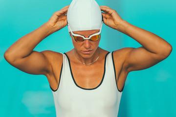 Female swimmer prepraing for race