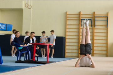 GOMEL, BELARUS - 22 April 2017: Freestyle competitions among young men and women in 2004-2006. In the program trampoline and gymnastic path