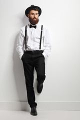 Elegant man with suspenders and a bow tie