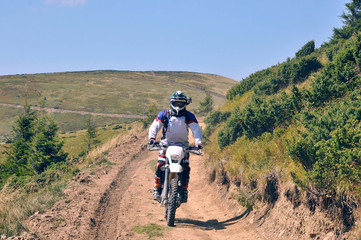 motorcyclists in helmets, motocross in the mountains