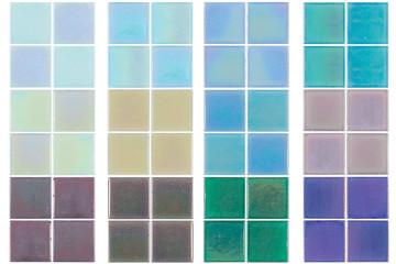 Set of multicolored iridescent ceramic tiles on white background