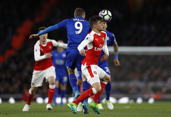 Arsenal's Gabriel Paulista in action with Leicester City's Jamie Vardy