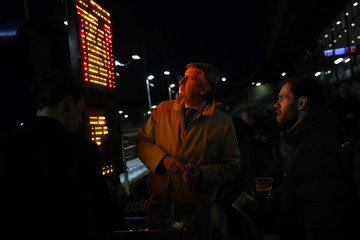 A bookmaker takes a bet during the final greyhound racing day at Wimbledon Stadium in London