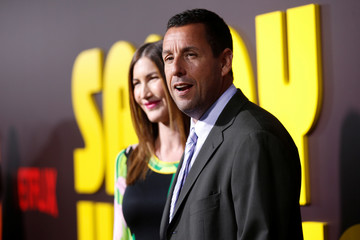 """Actor Adam Sandler and his wife Jackie pose at a premiere for the Netflix original film """"Sandy Wexler"""" in Los Angeles"""