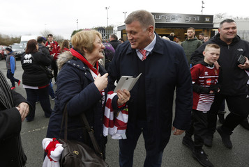 Wigan Warriors head coach Shaun Wane poses for photographs before the game