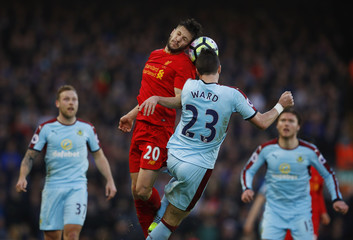 Liverpool's Adam Lallana in action with Burnley's Stephen Ward