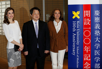 Queen Letizia of Spain poses for a photograph as she visits the Keio University Hospital in Tokyo