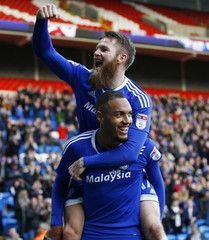 Kenneth Zohore celebrates scoring the fifth goal for Cardiff City with Aron Gunnarsson