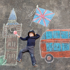 Little kid boy in british policeman uniform with London picture
