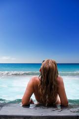Fotobehang Bleke violet Top view. Woman in swimming pool.