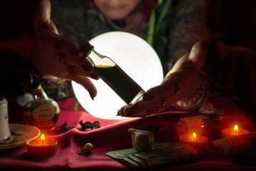 Woman fortune teller receive money from another woman