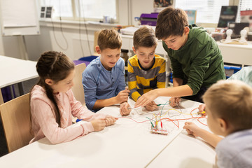 happy kids with invention kit at robotics school