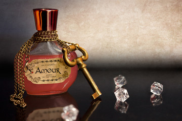 Amour love potion with chain and key around the bottle