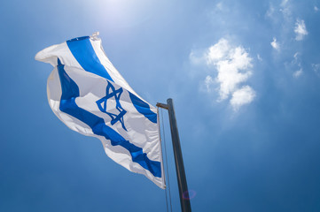 The flag of Israel in the blue sky stock image. Israeli flag, Yom Haatzmaut, Israel Independence Day, Zionsim. Herzl Mount, Jerusalem, Israel. June 2016.