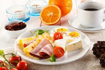 Breakfast with boiled egg, ham and cheese