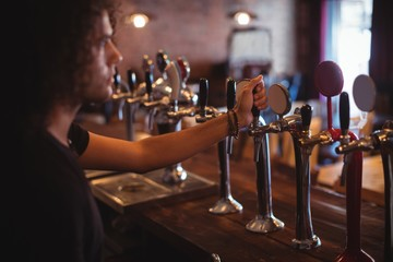 Male bar tender at bar counter