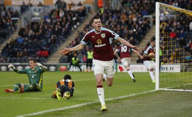 Burnley's Michael Keane celebrates scoring their first goal as Hull City's Eldin Jakupovic looks dejected