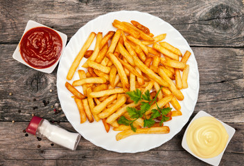 Top view on a plate with french fries