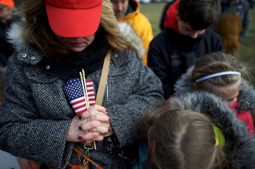 "Ellen Caruso prays during a ""People 4 Trump"" rally at Neshaminy State Park in Bensalem"