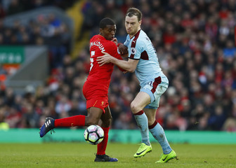 Burnley's Ashley Barnes in action with Liverpool's Georginio Wijnaldum