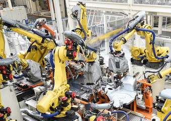 Welding robots surround the body of a VW Golf car in a production line at the plant of German carmaker Volkswagen in Wolfsburg