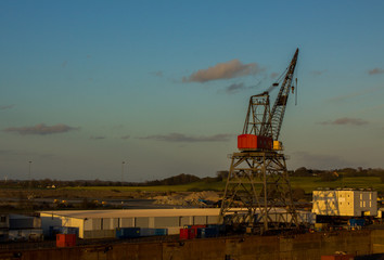 Crane in evening light in port of Odense, Denmark