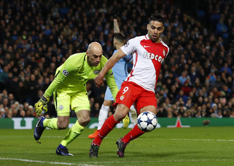 Monaco's Radamel Falcao in action with Manchester City's Willy Caballero