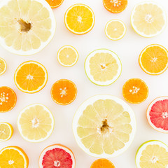 Food pattern of fresh citrus on white background. Flat lay, top view. Tasty fruits