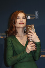 "Actress Isabelle Huppert holds her trophy during a photocall after receiving the Best Actress Award for her role in the film ""Elle"" at the 42nd Cesar Awards ceremony in Paris"