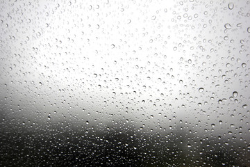 Falling raindrops on glass