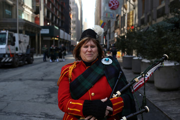 O'Westrick of the Staten Island Pipes and Drums band poses for a picture during the St. Patrick's Day Parade in New York City