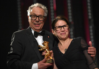 Festival director Dieter Kosslick hands over Golden Bear for Best Film 'On Body and Soul' to director Ildiko Enyedi during the awards ceremony at the 67th Berlinale International Film Festival in Berlin