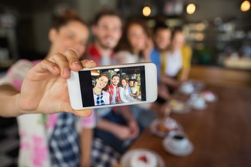 Friends taking photo in pub