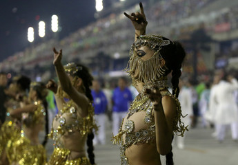 Revellers from Mocidade samba school perform during the second night of the carnival parade at the Sambadrome in Rio de Janeiro, Brazil
