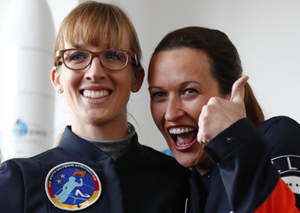 Thiele-Eich and Baumann pose for a picture after being announced by German Economy Minister Zypries as Germany's first female astronauts during a media event in Berlin