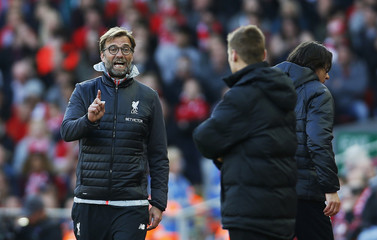 Liverpool manager Juergen Klopp gestures to the fourth official