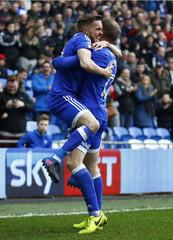 Craig Noone celebrates scoring the third goal for Cardiff City with Aron Gunnarsson (R)