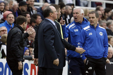 Wigan Athletic manager Graham Barrow has words with the Newcastle United coaching staff