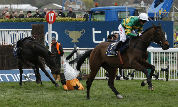 Lizzie Kelly falls from Tea for Two during the 3.30 Timico Cheltenham Gold Cup Chase
