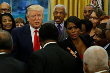 White House aide Omarosa Manigault directs traffic as U.S. President Donald Trump welcomes the leaders of dozens of historically black colleges and universities (HBCU) in the Oval Office at the White House in Washington