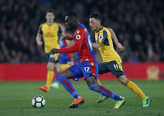 Crystal Palace's Christian Benteke in action with Arsenal's Mesut Ozil