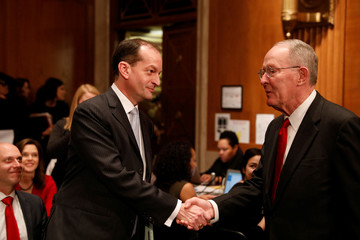 Alex Acosta, President Donald Trump's nominee to be Secretary of Labor, greets Sen. Lamar Alexander (R-TN) as he arrives for his confirmation hearing before the Senate Health, Education, Labor, and Pensions Committee on Capitol Hill