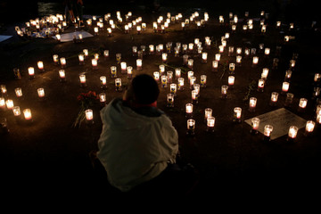 Candles are lit during a vigil for victims after a fire broke out at the Virgen de Asuncion home in San Jose Pinula on the outskirts of Guatemala City