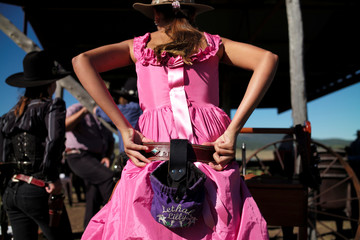 Lilly Brown, 14, wears an old west dress as she prepares to participate in the Women of the West shooting competition at the Namoi Pistol Club in Gunnedah in rural New South Wales