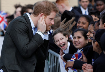 """Britain's Prince Harry speaks to pupils during a visit to the """"Yes You Can"""" project at Hamilton College in Leicester"""