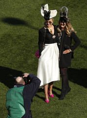 Racegoers pose for a picture at Cheltenham Festival