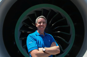 Embraer's commercial aviation chief Slattery poses for picture during the launch of the E195-E2 commercial jet's first prototype in Sao Jose dos Campos