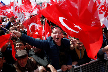 Supporters of Turkish President Tayyip Erdogan wave national flags during a rally for the upcoming referendum in Istanbul