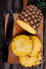 Fresh raw organic pineapple on a wooden background
