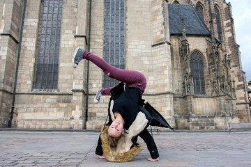 Young breakdance girl dancing breakdance on the street.
